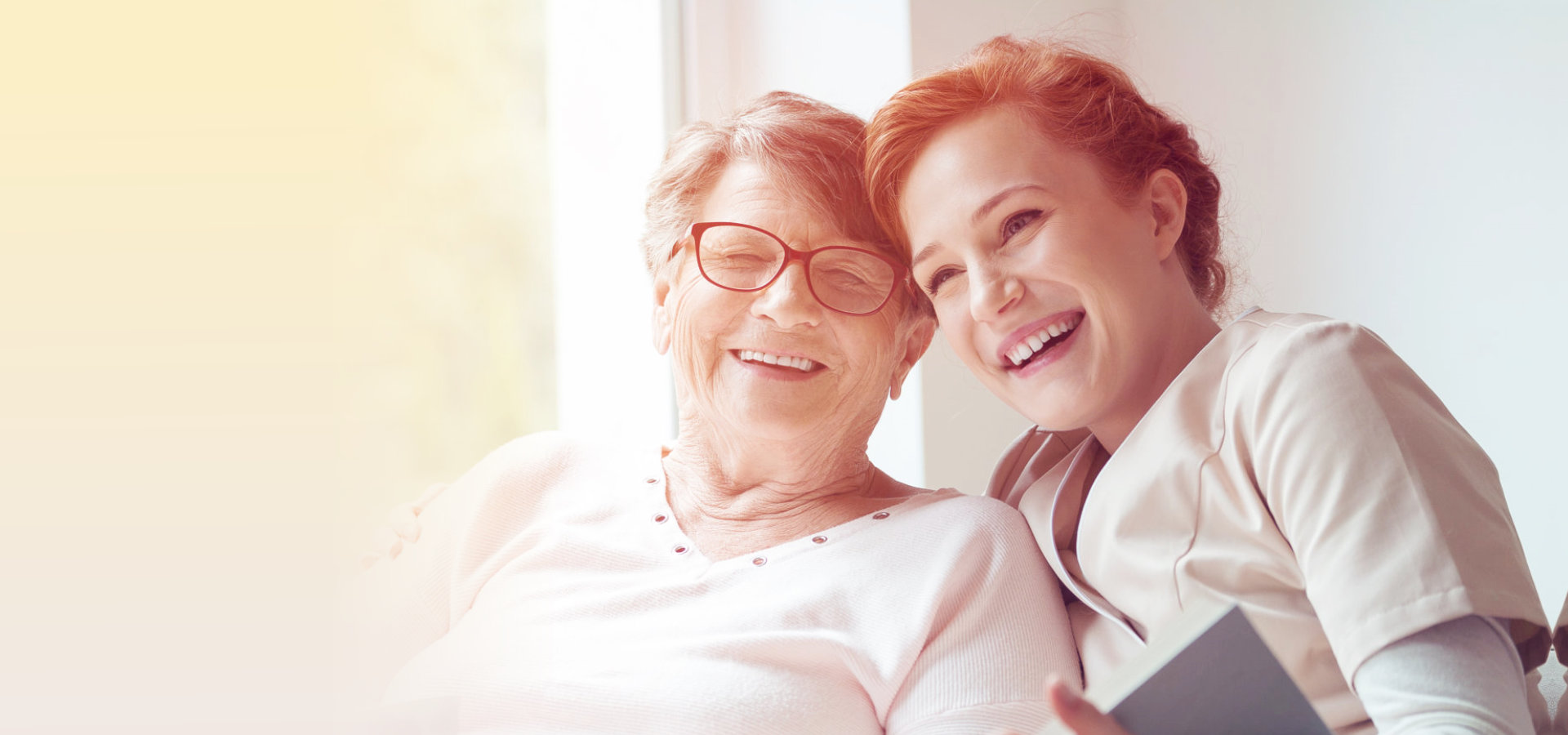 caregiver and elderly patient are smiling